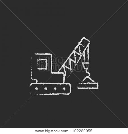 Lifting crane hand drawn in chalk on a blackboard vector white icon isolated on a black background.