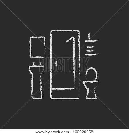 Bathroom hand drawn in chalk on a blackboard vector white icon isolated on a black background.
