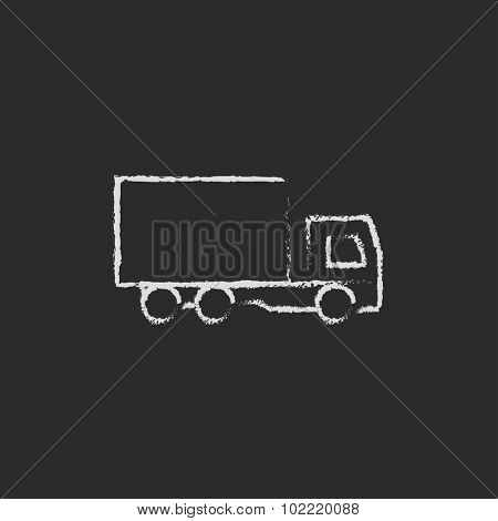 Delivery truck hand drawn in chalk on a blackboard vector white icon isolated on a black background.