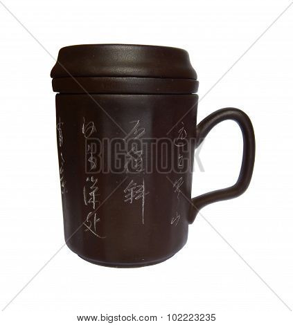 brown clay cup with lid on white background