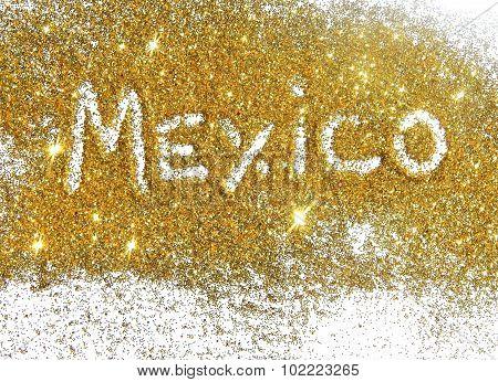 Blurry inscription Mexico on golden glitter sparkle on white background