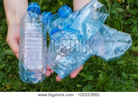 Plastic Bottles Of Mineral Water In Hand Of Woman, Littering Of Environment