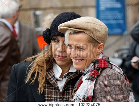 Two Smiling Ladies Wearing Old Fashioned Tweed Clothes