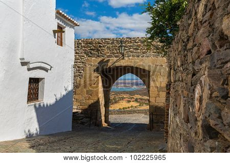Europe, Portugal, Evora, Monsaraz village - view from a traditional street to Alqueva Dam - the biggest artificial lake in Europe