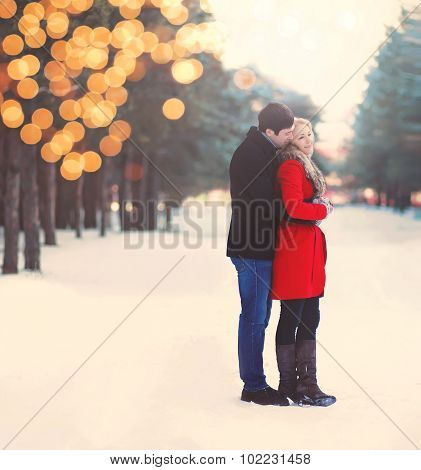 Silhouette Of Loving Couple Embracing In Warm Winter Day With Lights Bokeh, Vintage Colors