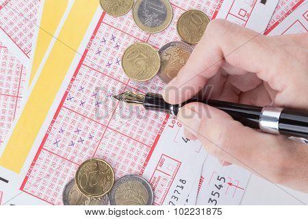 Female Hand Filling Lotto