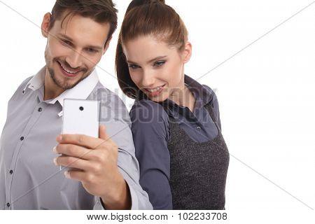 Young couple take selfie, studio isolated shoot
