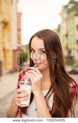Beautiful Girl Drinking A Milkshake