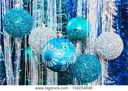 Christmas Balls Against The Backdrop Of Tinsel, Close-up