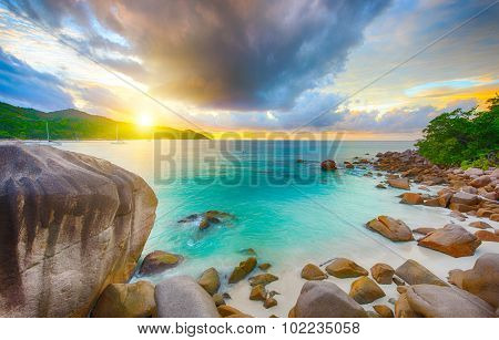 Beautiful sunset over the famous beach Anse Lazio seen from the granite boulders, Praslin island, Seychelles.
