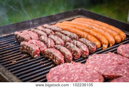 Grilling Meat On Barbecue Grill With Coal.