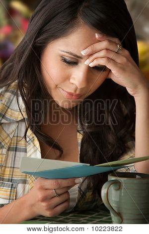Beautiful Sad Latina Woman With Sympathy Card