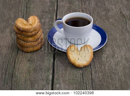 Pile Of Cookies And Cup Of Coffee On A Wooden Table