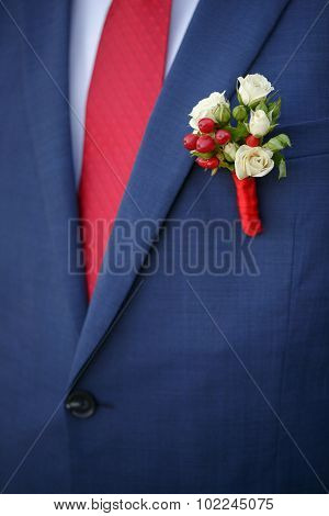 Wedding Boutonniere From Rose On Suit Of Groom