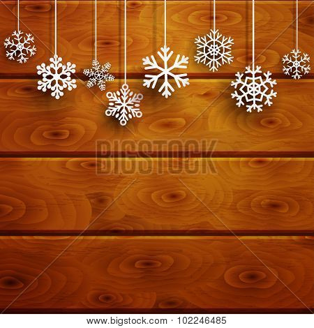 Christmas Background With Hanging Snowflakes On Wooden Planks