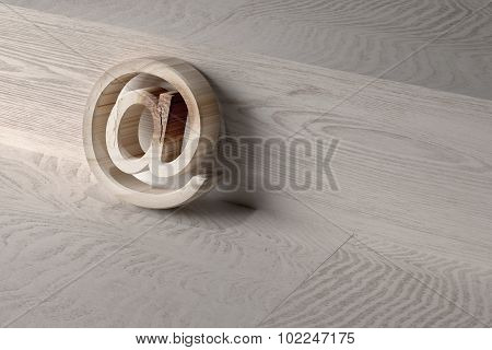 3D At On A Wooden Surface