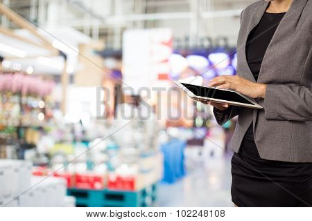 Woman Using Tablet In Shopping Mall.