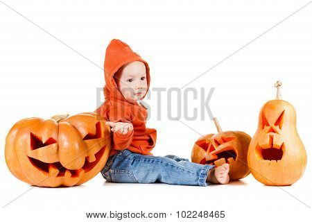 Baby and Halloween pumpkin. Isolated on white