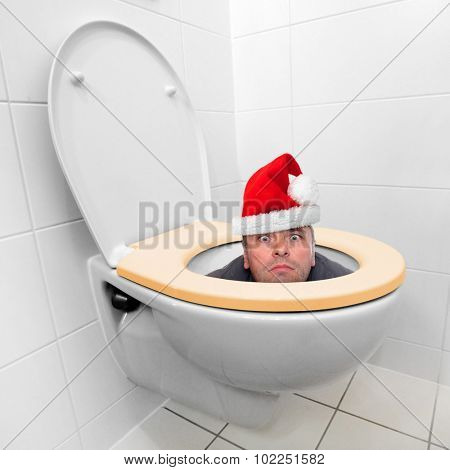 Santa Claus looking from the toilet bowl. Theme for funny christmas cards.