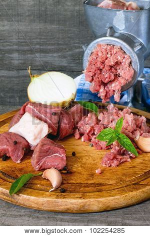 Beef, Onions And Raw Meat On A Dark Gray Wooden Table