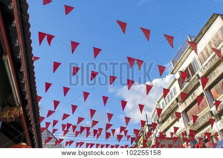 Red pennant Hanging above on the roof shrine.