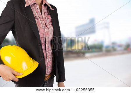 Engineer Holding Yellow Helmet For Workers Security On Background