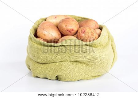 pure potatoes tubers in a bag isolated on white background