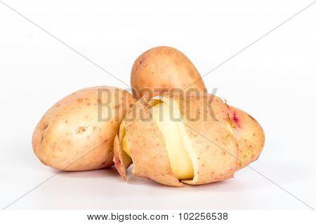 pinstripe skins peeled potatoes isolated on white background