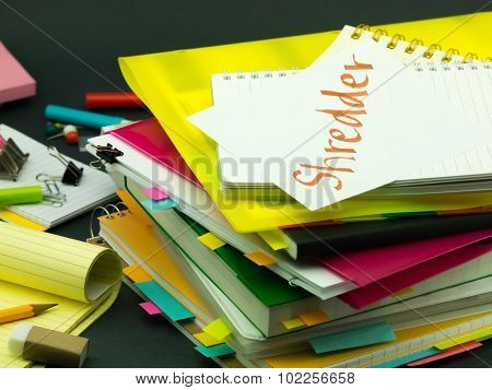 The Pile Of Business Documents; Shredder