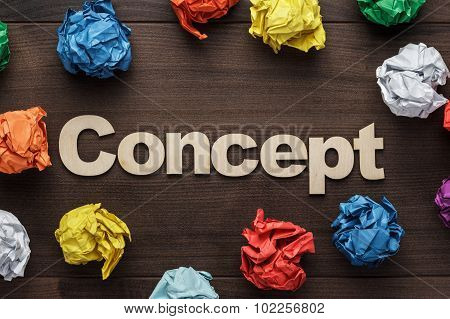 word concept and crumpled colorful paper