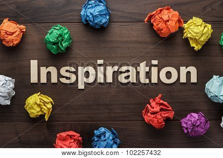 word inspiration and crumpled colorful paper