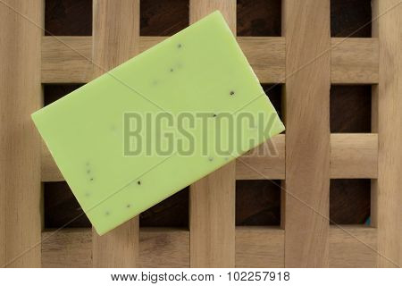 Green Soap On A Textured Wooden Background