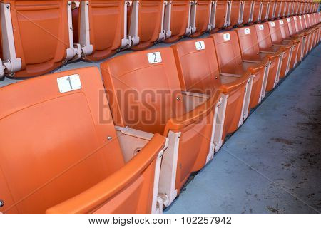 Orange stadium seats on the stadium sport