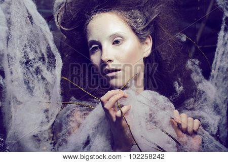 beauty woman with creative make up like cocoon, halloween celebration