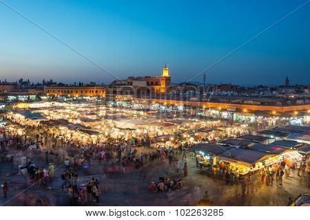 MARRAKESH, MOROCCO - APRIL 12, 2015: Djemaa el-Fna square at night getting busy with locals and tourists in the general street market buying and selling food and tradicional merchandise.