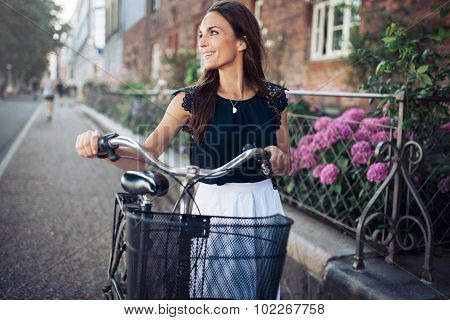 Smiling Woman With Bike Walking Down The Street