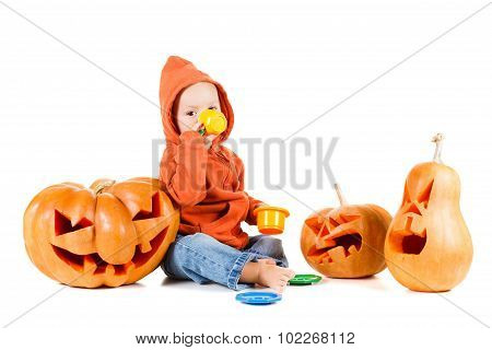 Baby and Halloween pumpkin. Isolated on white background