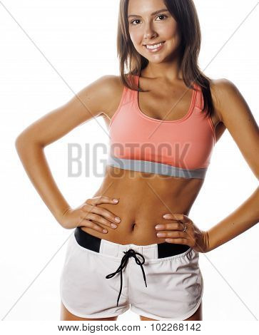 young pretty woman in sports wear isolated on white smiling