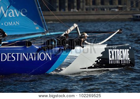 ST. PETERSBURG, RUSSIA - AUGUST 22, 2015: Bowman Nasser Al Mashari (left) and tactician Sarah Ayton on the catamaran The Wave, Muscat during 3rd day of St. Petersburg stage of Extreme Sailing Series