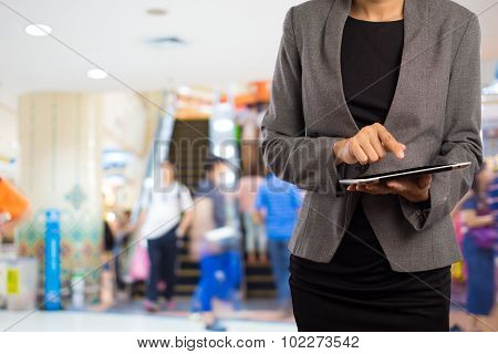 Businesswoman In The Shopping Mall.