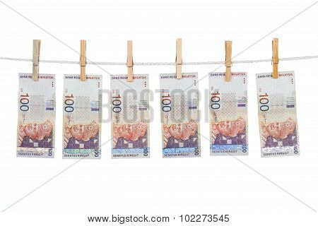 Malaysia Currency On Clothesline