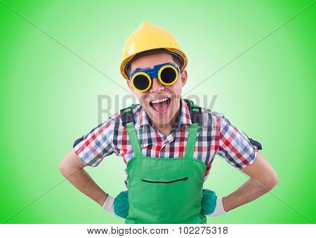 Funny construction worker isolated on white