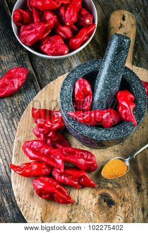 Pungent Peppers Bhut Jolokia On Wooden Table