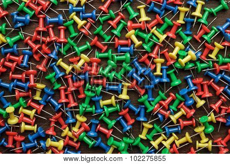bright colorful push pins background