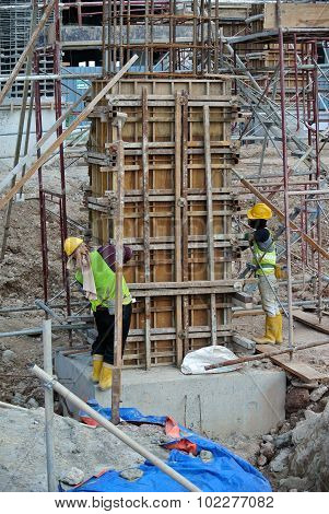 Two of construction worker fabricating column formwork