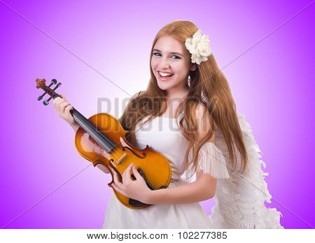 Young violin player isolated on white