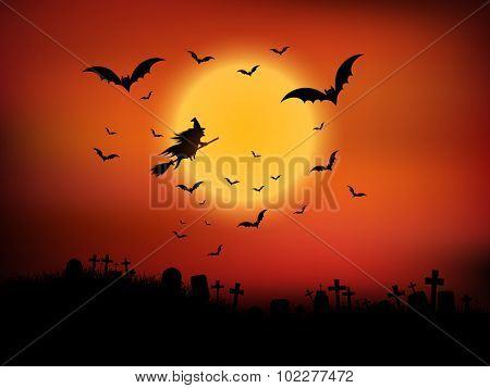 Halloween landscape with witch flying through the air