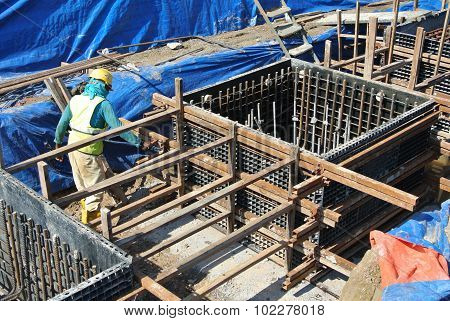 Construction workers installing pile cap formwork