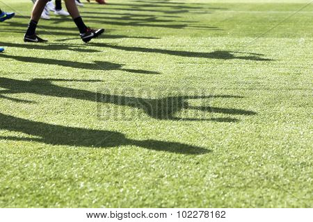 The Feet Of The Players Of Paok With Their Shadows During Team Practice In Thessaloniki, Greece.