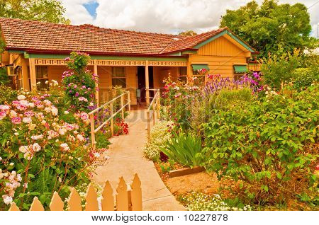 Richly Hued Cottage Complimented by its Equally Bright Spring Garden